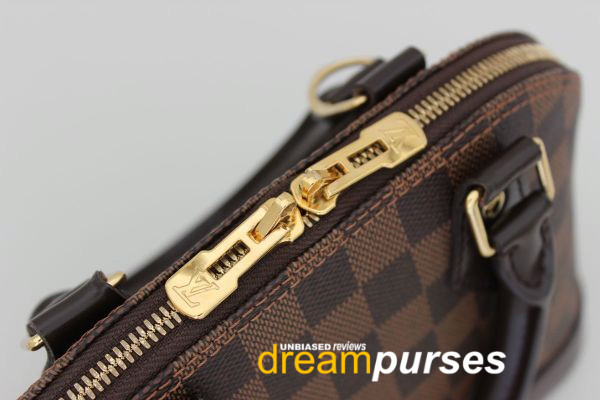 Louis Vuitton Alma replica zipper lock